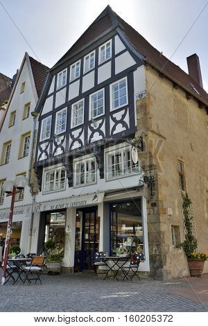 Osnabruck, Germany - April 22, 2016. Historic building dating 1533 on Krahnstrassehe 4 in Osnabruck, with commercial properties.