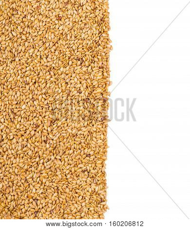 Background texture of roasted golden flax seed or linseed with healthy omega-3 fatty acids dietary fiber rich in oils and used to lower cholesterol