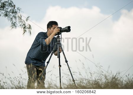 Professional Travel On Location And Nature Videographer/photographer (man) Photographing Nature And