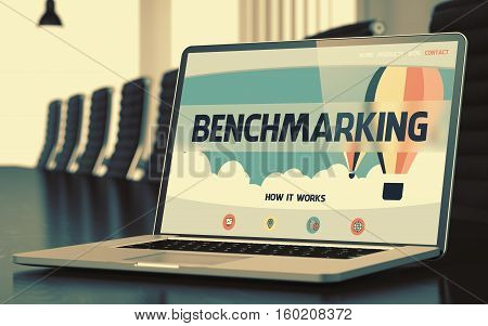 Benchmarking on Landing Page of Laptop Display in Modern Conference Hall Closeup View. Toned Image. Selective Focus. 3D Rendering.