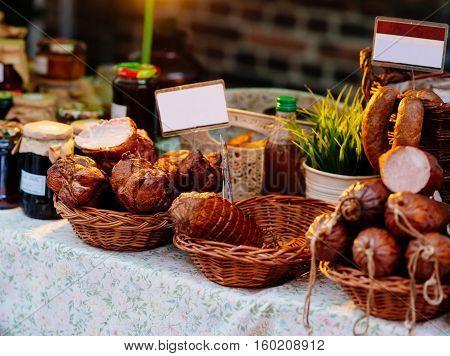 Traditional Polish smoked ham and sausages sold na Christmas market