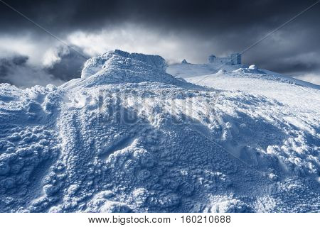 Winter landscape in the mountains. The old observatory on top. Beautiful texture of snow and neve. Carpathians, Ukraine, Europe