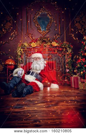 Santa Claus bring gifts for Christmas. The house is beautifully decorated for Christmas.
