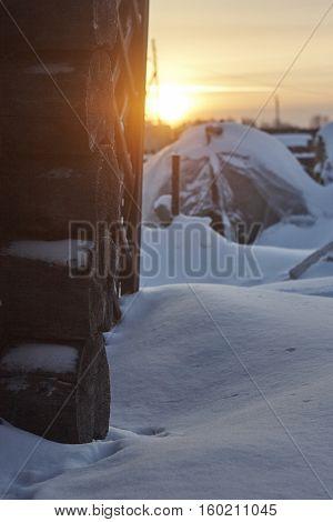 blockhouse corner in snow and winter sunset