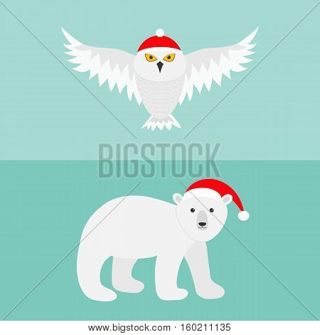 Snowy white owl. Polar bear. Red Santa hat. Flying bird with big wings. Arctic animal. Cute cartoon character. Merry Christmas greeting card. Flat design. Blue background. Vector illustration