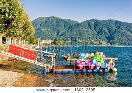 Ascona, Switzerland - August 25, 2016: Catamarans at the promenade of the luxurious resort in Ascona on Lake Maggiore in Ticino canton in Switzerland.