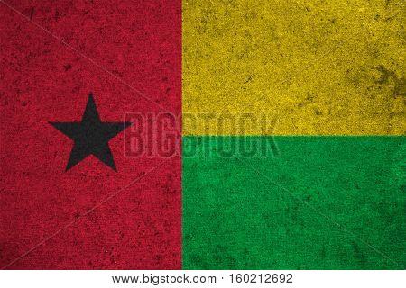 Guinea Bissau Flag On An Old Grunge Background