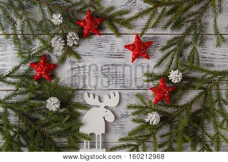 Wooden White Christmas Deer Decoration On Wooden Background. Chistmas Consept. Top View.