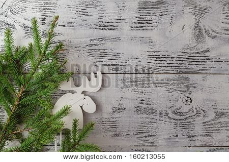 Wooden White Christmas Deer Decoration On Wooden Background. Chistmas Consept. Top View