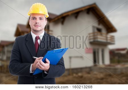Handsome Construction Inspector On Building Site