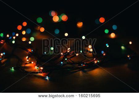 Christmas lights and vintage lantern on black background. Merry Christmas. Christmas. Happy Christmas. Christmas background. Christmas light. Christmas decorations.