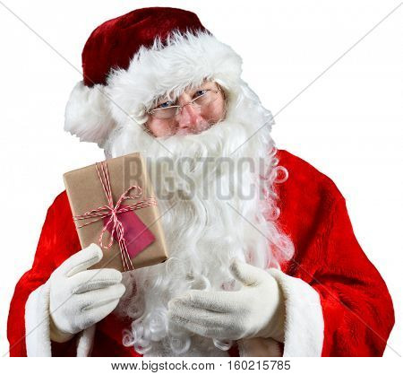 Santa Claus holding a plain brown wrapped package. The eco friendly recyclable gift is tied with string and has a blank gift tag. Over White.