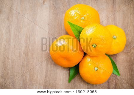 Fresh Organic Tangerines on a Wooden Background. Delicious and Beautiful Tangerines. Selective Focus. Top View