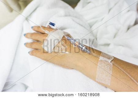 Closeup Of Hands With Intravenous Tube To Patient's