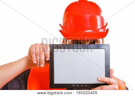 Technological development in company. Young handsome man worker in safety vest and hard hat with tablet. Repairman inspector at work isolated on white.