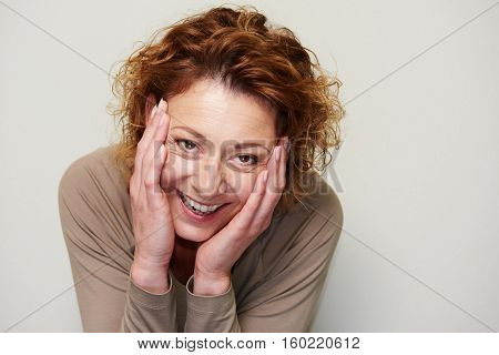 Expressive Woman Holding Head In Hands In Surprise