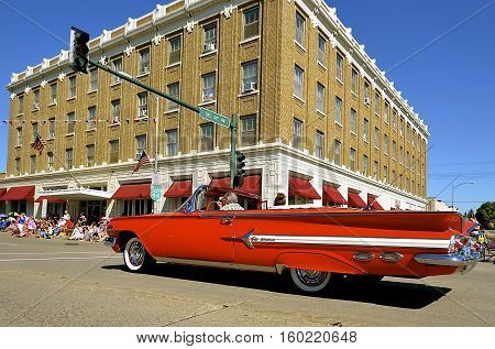 MANDAN, NORTH DAKOTA, July 3, 2016: The 4th of July Rodeo Days  3 day celebration includes the rodeo, Art in the Park, and downtown 4th parade where this red 1959 Chevrolet Impala convertible is featured.