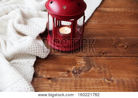 Christmas Candle On A Wooden Table