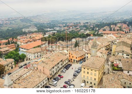 SAN MARINO SAN MARINO REPUBLIC - SEPTEMBER 5 2016: Aerial view from the funicular on the city of San Marino.