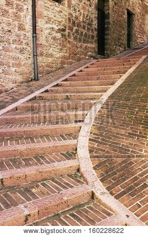 Narrow staircase up the street of the old town of Assisi Italy
