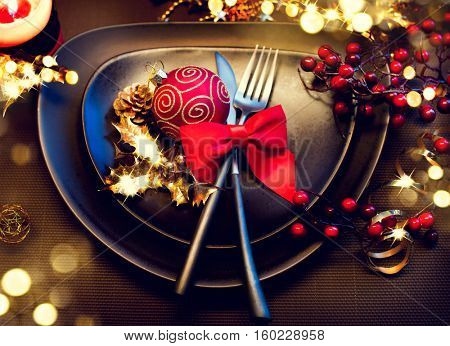 Christmas And New Year Holiday Table Setting. Celebration. Place setting for Christmas Dinner party. Holiday Decorations. Decor.