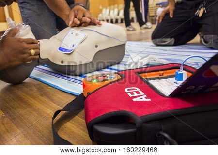 cpr with aed training and blur background poster