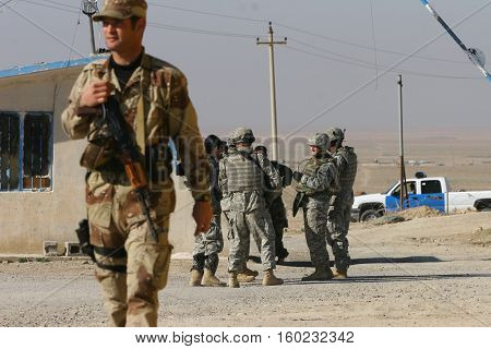 MAXMUR CITY, IRAQ-JANUARY 26:USA soldiers stands guard in a check point on January 26, 2007 in Maxmur, Iraq.