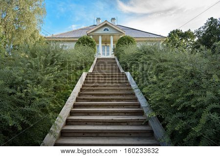 Pushkin Mountains, stairs leading to the house of the poet on the background of blue sky