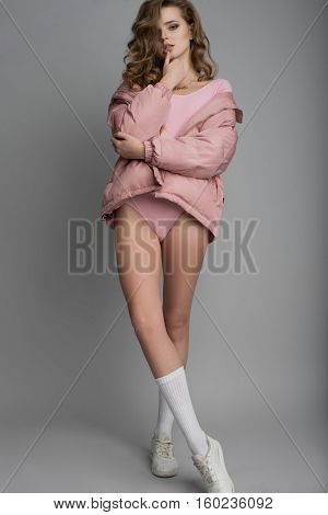 Fashion Studio Shot Of Leggy Attractive Model On Grey Background