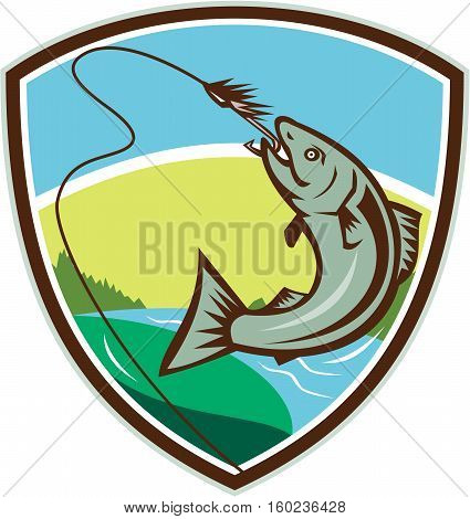 Illustration of trout biting hook lure viewed from the side set inside shield crest with river trees and sun in the background done in retro style.