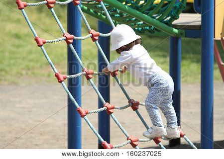 Japanese girl playing at field athletic (1 year old)