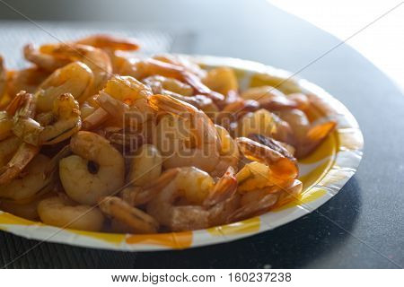 Fried shelled prawns with tails lie on the plate photo for you