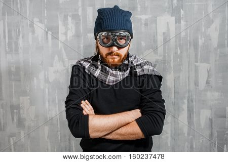 Retro Boy Pilot. The man in glasses and scarf, fantasy image of Aviator and visionary