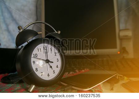 Black alarm clock at 5 o'clock Black retro clock Time out finish working