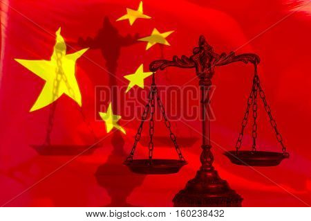 Decorative Scales of Justice with shadow on the Chinese flag