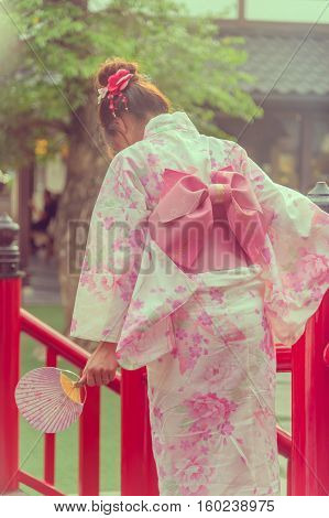 Japanese women wearing traditional Kimono walk on the garden Japan.