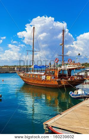 NESEBAR BULGARIA SEPTEMBER 06 2013: Wooden passenger sailing ship standing at the pier in the port of the old town of Nessebar on the Black Sea coast. Vertical shot.