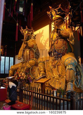 Statue of buddhist god inside Lognhua temple in Shanghai, China