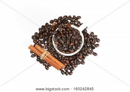 Coffee been Cinnamon sticks spice sweet fragrant on white background