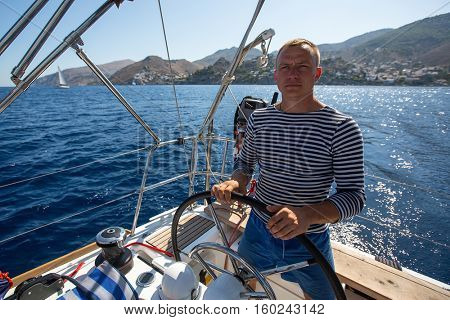 Yachtsman during in the boat race, sailing the Aegean sea.