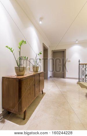Spacious Corridor With Vintage Cabinet