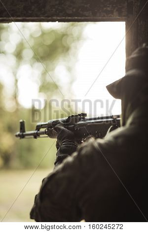 Soldier Firing Automatic Weapon