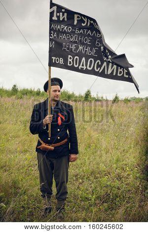 POKROVSKOE, SVERDLOVSK OBLAST, RUSSIA - JULY 17, 2016: Historical reenactment of Russian Civil war in the Urals in 1919. Soldier-anarchist