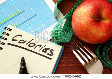 Calories written in a diary. Calorie counting concept.