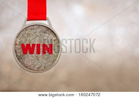 Winner medal on on bokeh lights background. Success win concept.
