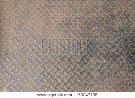 Grunge rustic diamond steel plate texture and background