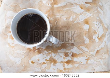 Hot coffee on worn paper with coffee stains and rough