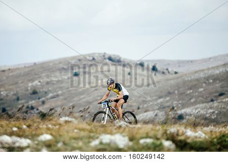 Privetnoye Russia - September 21 2016: young man rider mountainbiker rides in mountains during Crimean race mountainbike