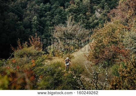 Privetnoye Russia - September 22 2016: male athlete mountainbiker rides on nature of mountain landscape during Crimean race mountainbike