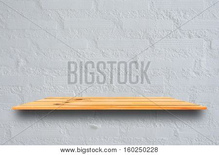 Empty top wooden shelves and stone wall background. Perspective brown wood shelves over stone wall background. - can be used for display or montage your products.Mock up for display of product.